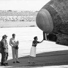 NANCY REAGAN LOOKS INSIDE WHEEL WELL OF SHUTTLE COLUMBIA - 8X10 PHOTO (BB-257)