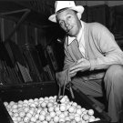 BING CROSBY WITH GOLF BALLS FOR THE WWII SCRAP RUBBER DRIVE - 8X10 PHOTO (AA-854)
