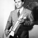 DR. WERNHER VON BRAUN HOLDS A MODEL OF THE V-2 ROCKET - 8X10 NASA PHOTO (EP-049)