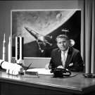 DR. WERNHER VON BRAUN AT HIS DESK WITH MODELS IN BACKGROUND 8X10 PHOTO (EP-136)