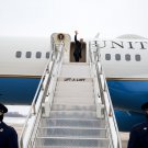 PRESIDENT BARACK OBAMA BOARDS AIR FORCE ONE IN UNIQUE SHOT - 8X10 PHOTO (CC-083)