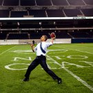 PRESIDENT BARACK OBAMA THROWS A FOOTBALL AT SOLDIER FIELD - 8X10 PHOTO (DD-069)