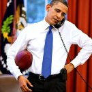PRESIDENT BARACK OBAMA ON THE PHONE WHILE HOLDING A FOOTBALL 8X10 PHOTO (ZZ-622)