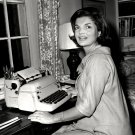 "JACQUELINE KENNEDY WRITING HER ""CANDIDATE'S WIFE"" COLUMN - 8X10 PHOTO (ZZ-596)"