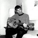"LEONARD NIMOY AS ""MR. SPOCK"" PLAYING A GUITAR - 8X10 PUBLICITY PHOTO (ZZ-578)"