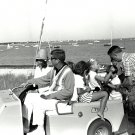 PRES JOHN F. KENNEDY RIDES IN GOLF CART WITH JACKIE & OTHERS 8X10 PHOTO (BB-626)
