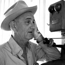 PRESIDENT LYNDON B. JOHNSON TALKS ON ANTIQUE PHONE AT TEXAS RANCH 8X10 PHOTO (BB-102)