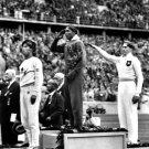 JESSE OWENS WINS GOLD @ THE 1936 SUMMER OLYMPICS IN BERLIN - 8X10 PHOTO (BB-093)