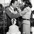 LAUREN BACALL FEEDS PIECE OF WEDDING CAKE TO HUMPHREY BOGART 8X10 PHOTO (EE-157)
