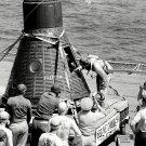 ALAN SHEPARD MERCURY ASTRONAUT PEERS INTO FREEDOM 7 ON SHIP 8X10 PHOTO (BB-148)