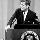 PRESIDENT JOHN F. KENNEDY AT A 1962 PRESS CONFERENCE - 8X10 PHOTO (AZ059)