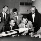MERCURY 7 ASTRONAUTS INSPECT A ROCKET MODEL - 8X10 NASA PHOTO (EP-093)