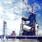 S-II STAGE OF THE SATURN ROCKET IS LIFTED ONTO TEST STAND - 8X10 PHOTO (EP-094)