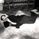GROUCHO MARX RELAXES ON A BEAR SKIN RUG - 8X10 PUBLICITY PHOTO (EP-536)
