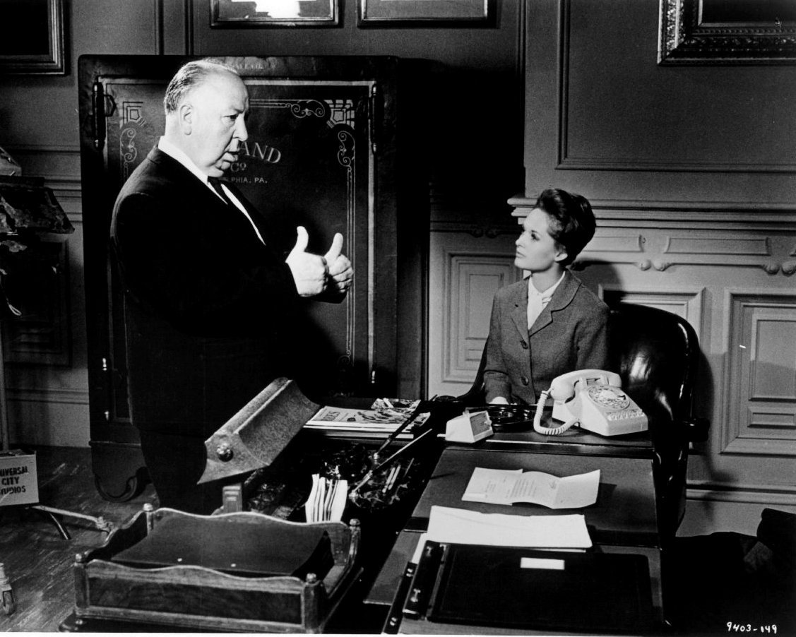 "ALFRED HITCHCOCK AND TIPPI HEDREN ON THE SET OF ""MARNIE"" - 8X10 PHOTO (ZY-499)"