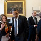 PRESIDENT BARACK OBAMA TALKS WITH NANCY PELOSI IN 2011 - 8X10 PHOTO (ZY-515)