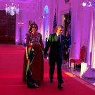 BARACK OBAMA AND MICHELLE WALK DOWN CROSS HALL IN 2014 - 8X10 PHOTO (ZY-561)