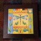 Wood framed colorful ceramic tile pot holder