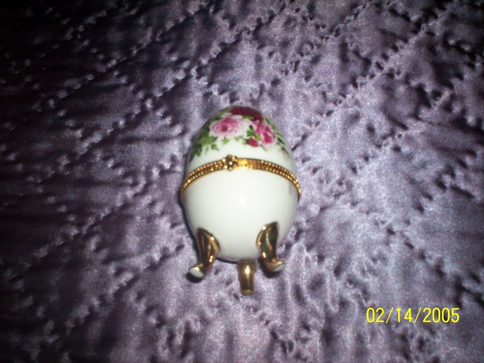 Egg shaped white trinket  w/ flowers