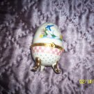 Egg shaped trinket with bunny.