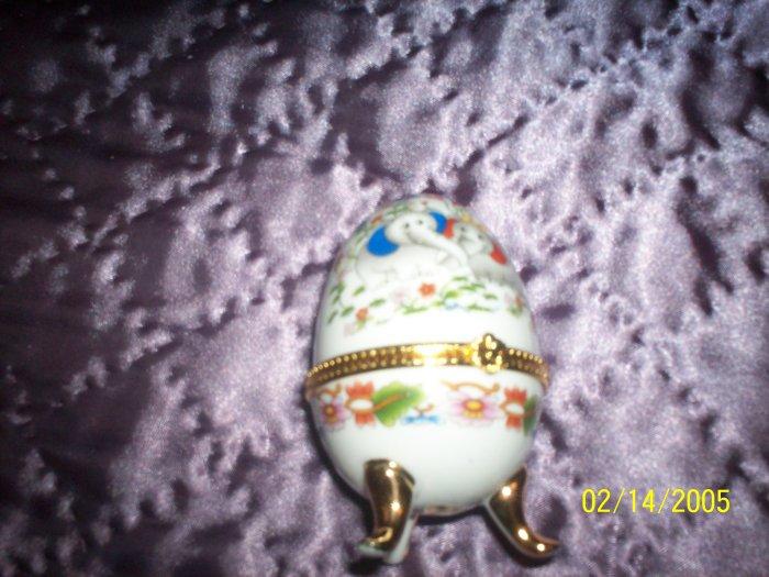 Egg shaped trinket with Elephants and flowers