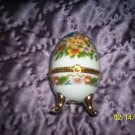 Egg shaped trinket w/ bunnies and flowers.j