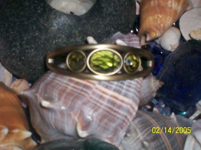 Brass bangle with green peridots