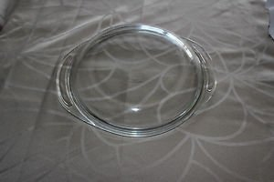 Pyrex lid 684-c13. Small chips along outer edge.