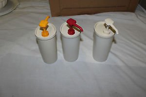 3 Vintage Tupperware pumps. Ketchup, mustard and mayo pumps.