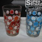 2 Vintage drinking glasses. Unmarked. Circles dots red blue