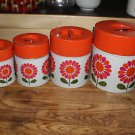 Mid-century metal 4 nesting canister. Japan. Orange, pink, green floral. HTF