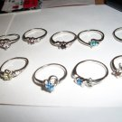 Various size 5's Rhodium plated rings