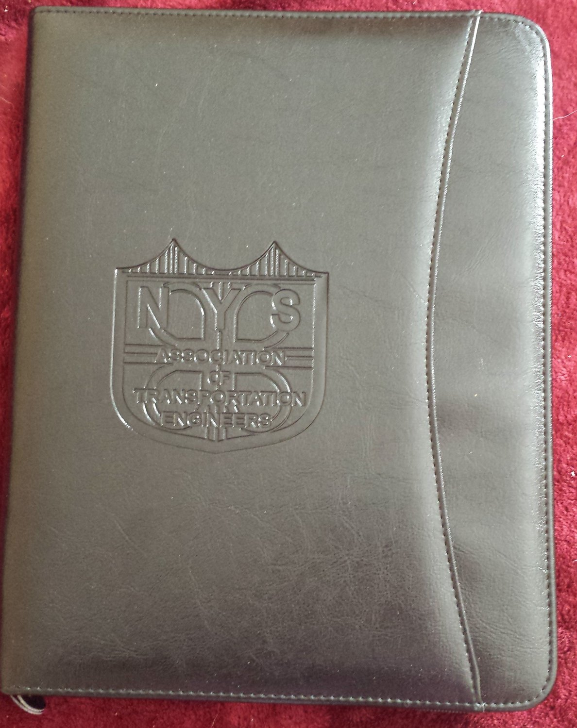 Black zippered padfolio with NYSATE logo