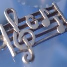 vintage CHARM : UNMARKED SILVER MUSICAL NOTES