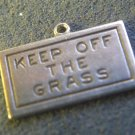 "vintage CHARM : UNMARKED SILVER : READS ""KEEP OF THE GRASS"""