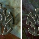 vintage STERLING LOVER CHARM :  ROUND CUT OUT LETTERS : SPENCER?