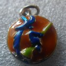 ENAMEL HALLOWEEN CHARM : WITCH ON A BROOMSTICK / ORANGE  BACKGROUND