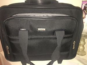 Solo luggage suit case carry on tag along pull rolling wheels bag travel