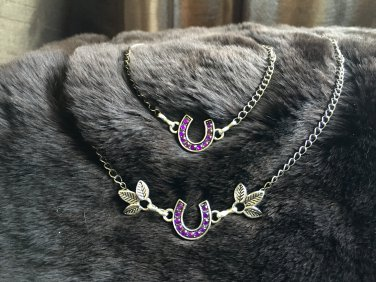 Purple and silver tone horseshoe necklace and bracelet set