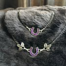 Purple and silver tone horseshoe necklace and bracelet set