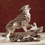 ALAB. HOWLING WOLF ON SNOW