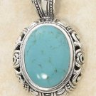 Sterling Silver Large Oval Turquoise Pendant with Scrolled Dome Border