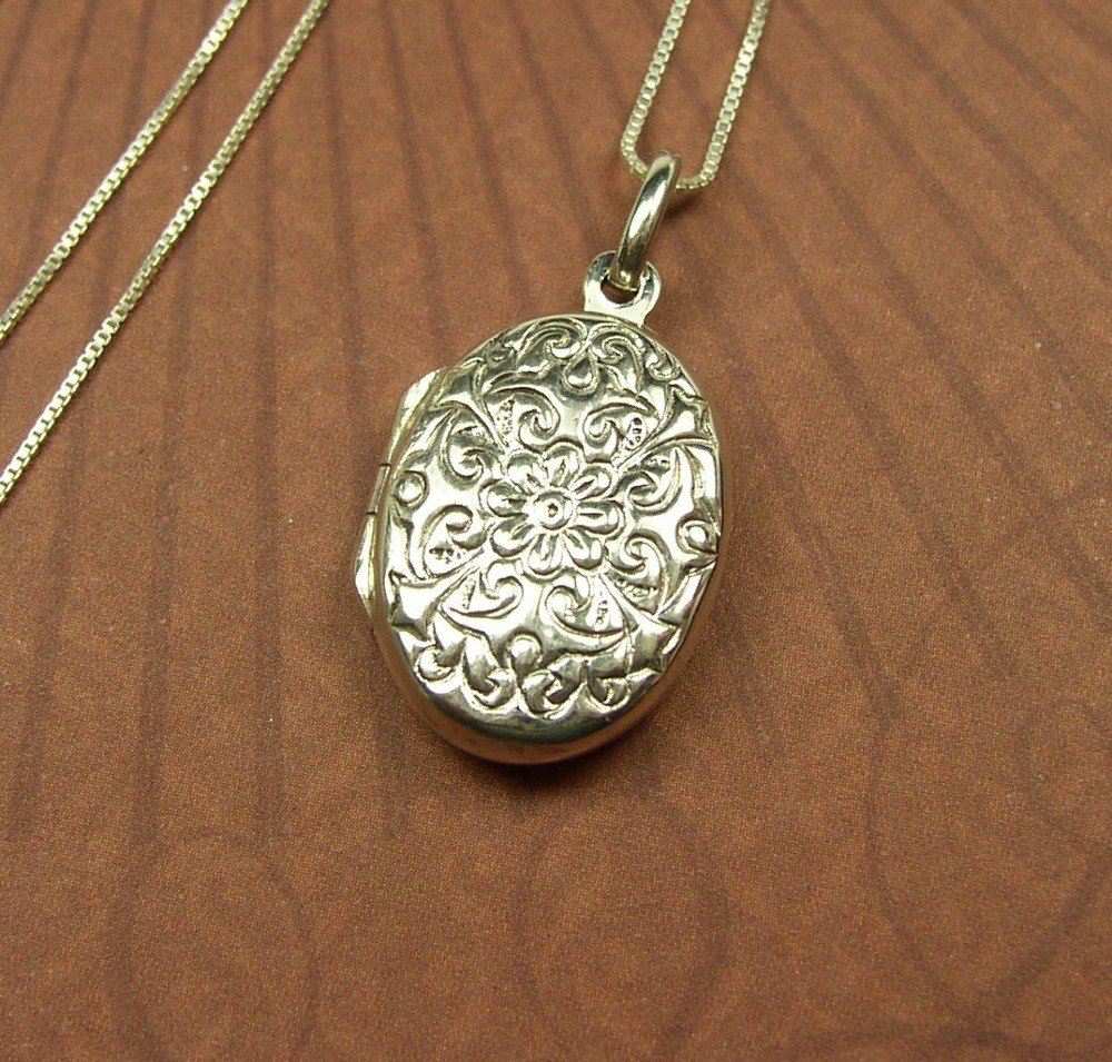 Sterling silver Oval locket with a floral design and chain necklace
