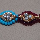Dual Colored Rakhi in Turq & Ruby Red Beads & Threads With Crystals By Teknowear