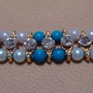 Dual Colored Rakhi in Turquoise & Amethyst With Clear Crystals By Teknowear