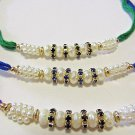 Rakhi with Gold Tone Natural Pearls in Emerald, Aqua , Amethyst Crystal  Stones