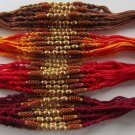 Tulsi/Basil Brown Beads Rakhi in Gold Tone With brown beads by Teknowear.