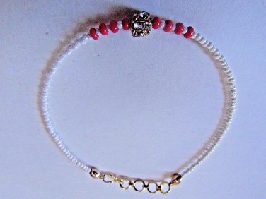 Fuchsia Gold Crystal Rakhi/Bracelet With Ivory Beads By Teknowear