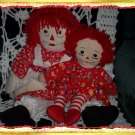 Two Raggedy Ann Dolls