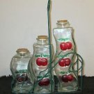 SET OF THREE GLASS BOTTLES  CHERRIES CRUET VINEGAR IN WIRE RACK